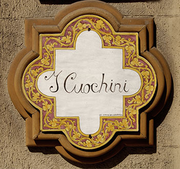 Cuochini's sign in 68 Ruggero Settimo street, Palermo, Italy